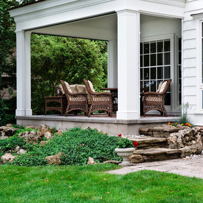 Classic porch idea in Toronto with a roof extension