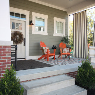 Arts and crafts concrete front porch idea in Indianapolis with a roof extension