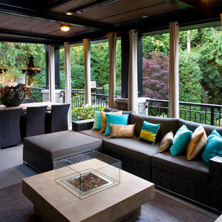 Inspiration for a transitional porch remodel in Vancouver with a roof extension