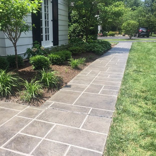 Mid-sized tuscan stamped concrete front porch idea in St Louis