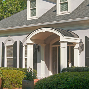 Inspiration for a timeless brick front porch remodel in Atlanta with a roof extension