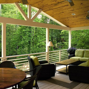 Inspiration for a large contemporary screened-in back porch remodel in Atlanta with decking and a roof extension