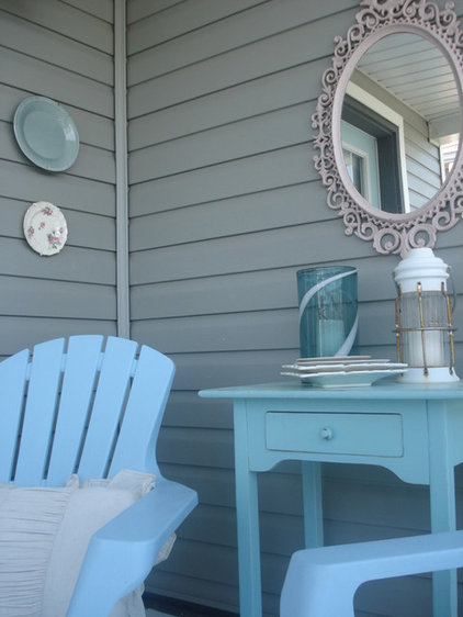 Traditional Porch by Chris  Kauffman