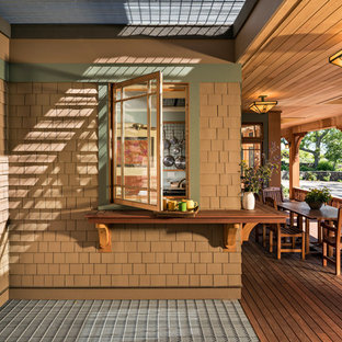 Arts and crafts porch idea in Boston with a roof extension