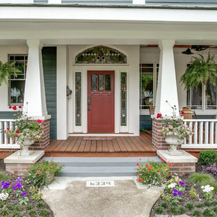 This is an example of a large craftsman front porch design in Dallas with decking and a roof extension.