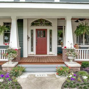 Idéer för en stor amerikansk veranda framför huset, med trädäck och takförlängning