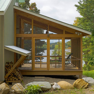 Design ideas for a rustic screened veranda in Burlington with decking and a roof extension.