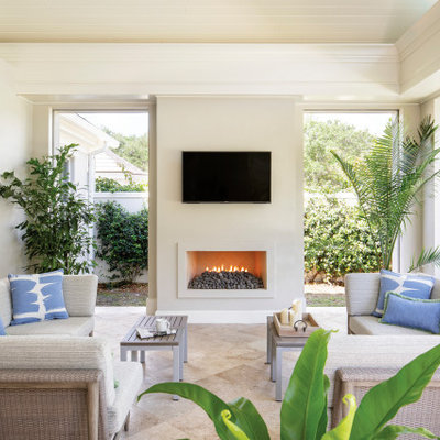 Mid-sized beach style tile screened-in back porch photo in Miami with a roof extension