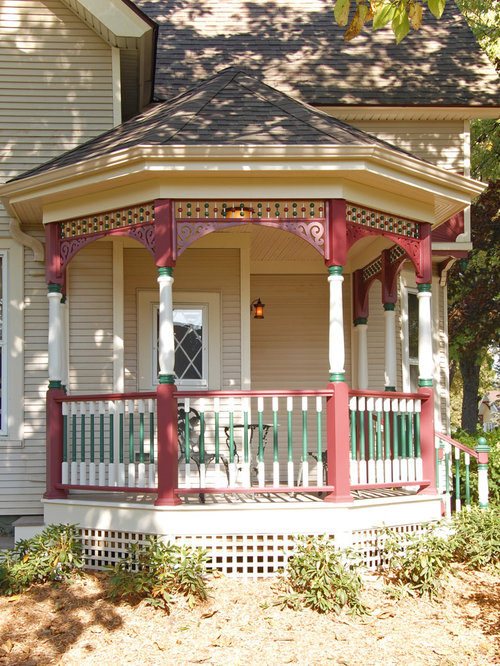 Ornate Porch Idea In Milwaukee With A Roof Extension