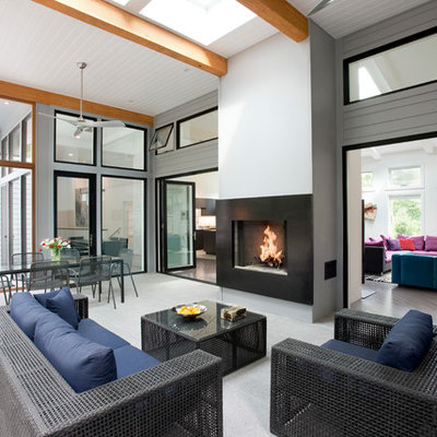 Inspiration for a large contemporary tile screened-in back porch remodel in Boston with a roof extension