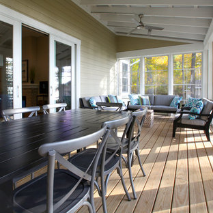 Inspiration for a small coastal screened-in back porch remodel in Grand Rapids with decking and a roof extension