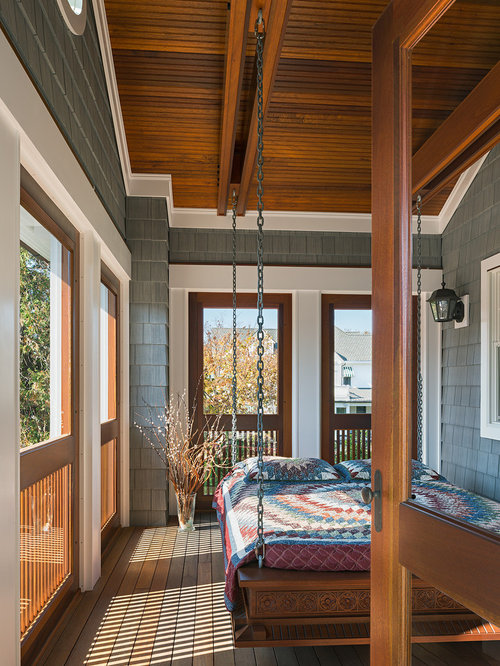 this is an example of a large traditional screenedin back porch design in new