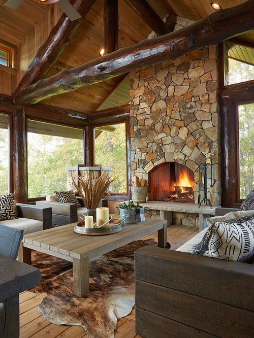 this is an example of a rustic screened in porch design in minneapolis with decking - Log Cabin Design Ideas