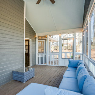 Mid-sized transitional screened-in back porch idea in Birmingham with a roof extension