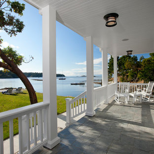 This is an example of a traditional porch design in Vancouver with a roof extension.