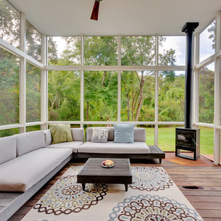 Trendy screened-in porch photo in Boston with decking and a roof extension
