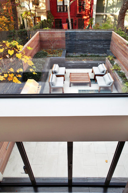 Modern Porch by moment design + productions, llc