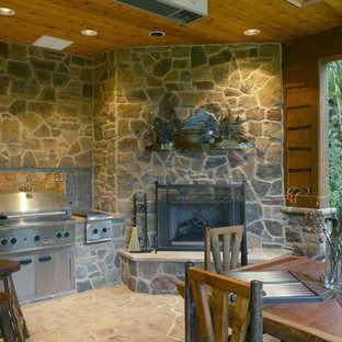 Mountain style porch idea in Portland with a fire pit
