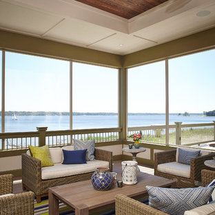 Inspiration for a beach style screened-in porch remodel in Grand Rapids with decking and a roof extension