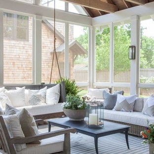 Large transitional screened-in back porch idea in Nashville with decking and a roof extension