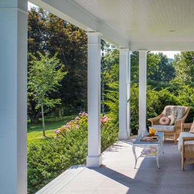 Inspiration for a farmhouse front porch remodel in DC Metro with decking and a roof extension