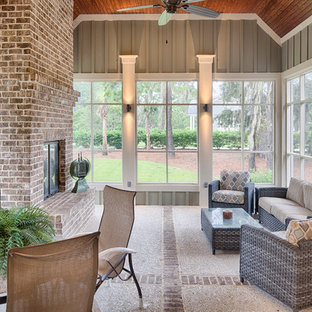 Mid-sized elegant stamped concrete screened-in back porch photo in Charleston with a roof extension