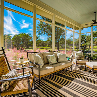 Farmhouse screened-in porch photo in Austin with a roof extension