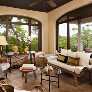 Tuscan porch photo in Austin with a roof extension