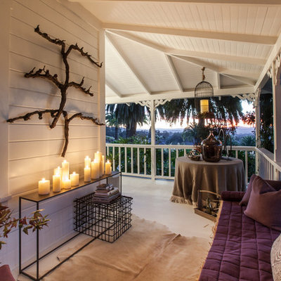 Mid-sized country side porch photo in San Francisco with a roof extension