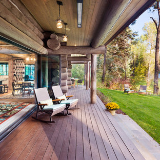 This is an example of a rustic porch design in Denver with decking and a roof extension.