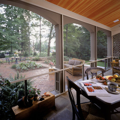 Elegant porch photo in New York with a roof extension