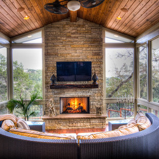 Large eclectic screened-in back porch photo in Austin with decking