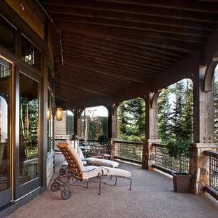 Elegant porch photo in Salt Lake City with a roof extension