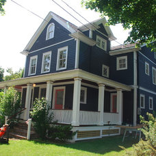 Traditional Porch Wrap around porch..prussian blue exterior..Nantucket Red doors.
