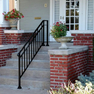 Mid-sized arts and crafts front porch idea in Wichita