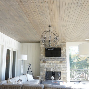 Inspiration for a large craftsman screened-in back porch remodel in Cleveland with a roof extension