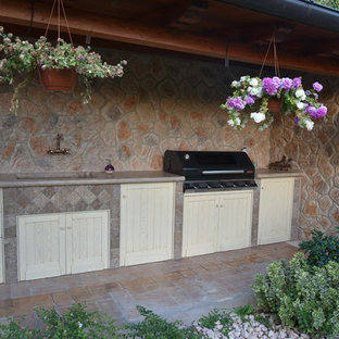 Inspiration for a shabby-chic style outdoor kitchen porch remodel in Rome