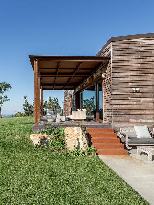 Foto e idee per patii e portici patio o portico in for Aggiungendo un portico ad un ranch