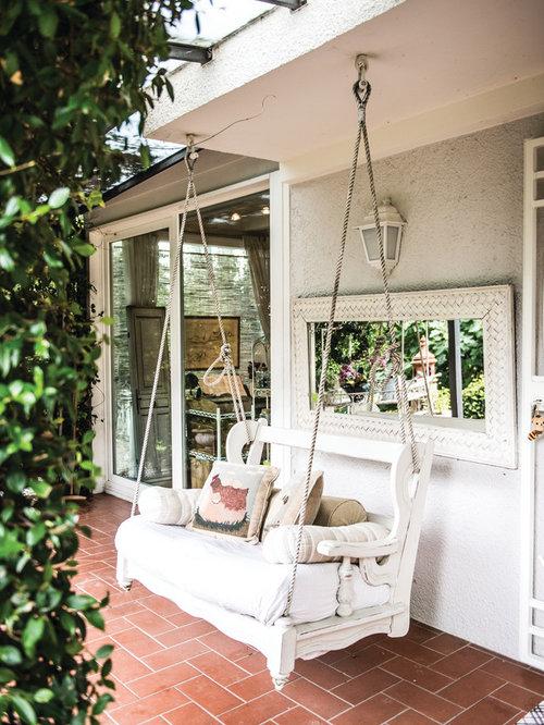 Foto e idee per esterni esterni shabby chic style for Case in stile meridionale con avvolgente portico
