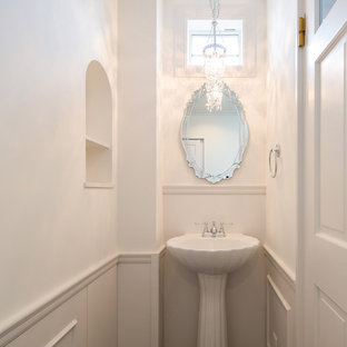 Inspiration for a traditional powder room in Other.