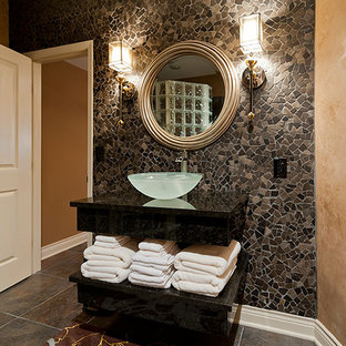 Medium sized contemporary cloakroom in Kansas City with flat-panel cabinets, black cabinets, a two-piece toilet, multi-coloured tiles, mosaic tiles, brown walls, slate flooring, a vessel sink and solid surface worktops.