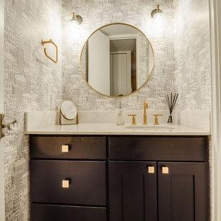 Réalisation d'un petit WC et toilettes design avec un placard à porte shaker, un WC séparé, un carrelage blanc, des carreaux de céramique, un lavabo encastré, un plan de toilette en marbre, des portes de placard en bois sombre, un mur blanc et un plan de toilette blanc.