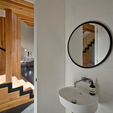 Contemporary Powder Room by Auhaus Architecture