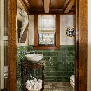 На фото: туалет среднего размера в классическом стиле с темными деревянными фасадами, разноцветными стенами, настольной раковиной, белым полом, фасадами островного типа, раздельным унитазом, зеленой плиткой, плиткой кабанчик, полом из мозаичной плитки, столешницей из дерева и коричневой столешницей с