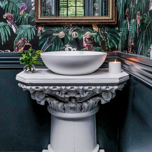 Powder room - mid-sized eclectic white tile ceramic floor and gray floor powder room idea in New York with a one-piece toilet, a vessel sink, white countertops and multicolored walls