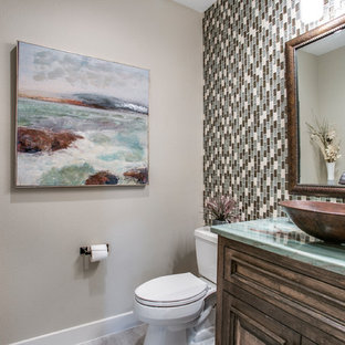 Photo of a medium sized classic cloakroom in Dallas with freestanding cabinets, brown cabinets, a two-piece toilet, multi-coloured tiles, mosaic tiles, grey walls, porcelain flooring, a vessel sink, onyx worktops, grey floors and turquoise worktops.