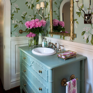 Inspiration for a small classic cloakroom in St Louis with freestanding cabinets, green walls, dark hardwood flooring, a built-in sink, wooden worktops, blue cabinets and turquoise worktops.