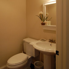Traditional Powder Room by Kaufman Construction Design and Build