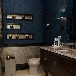 Идея дизайна: маленький туалет в стиле современная классика с врезной раковиной, темными деревянными фасадами, столешницей из гранита, унитазом-моноблоком, разноцветной плиткой, стеклянной плиткой, синими стенами и полом из известняка