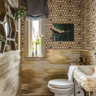 Inspiration for a medium sized contemporary cloakroom in San Francisco with a two-piece toilet, multi-coloured walls, porcelain flooring, matchstick tiles, multi-coloured tiles, a console sink and brown floors.